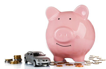 Piggy bank with car toy and coins around, isolated on white Banque d'images - 102900602