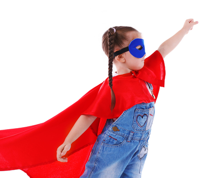 Cute little girl dressed as superhero isolated on white background