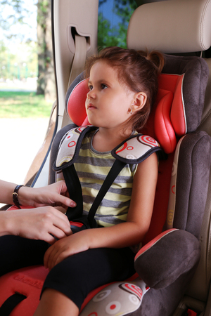 Adorable little girl in the car 写真素材