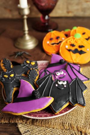 Creative Halloween cookies on wooden background Stok Fotoğraf
