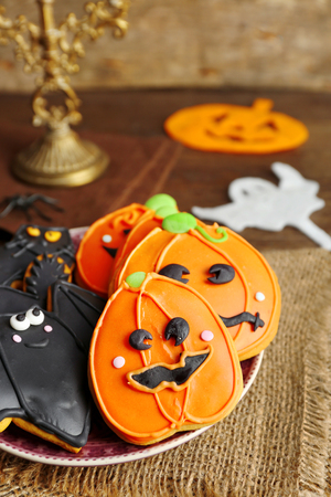 Creative Halloween cookies on wooden background Stock Photo
