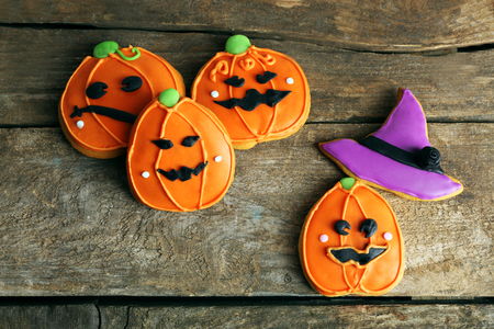Creative cookies for Halloween party on wooden background