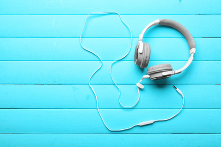 Headphones on blue wooden background Stock Photo