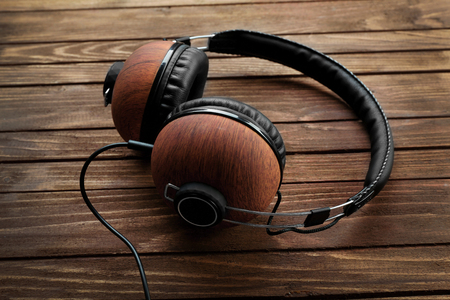 Headphones on brown wooden background Stock Photo
