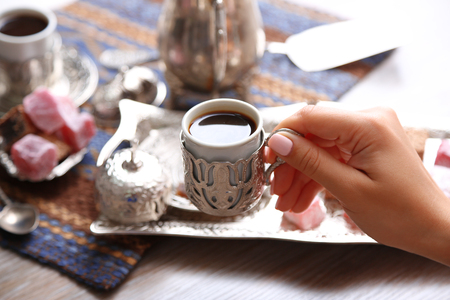 Antique tea-set with Turkish delight on table close-up Stock Photo