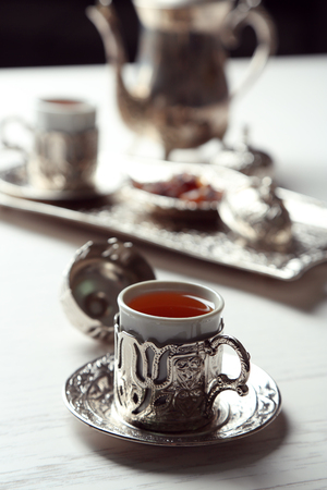 Antique tea-set on table close-up