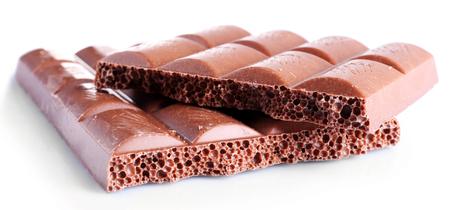 Broken chocolate bar, isolated on white Foto de archivo
