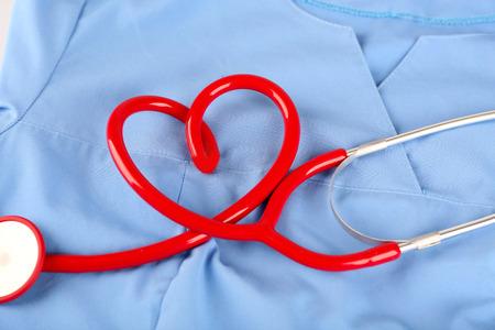 Stethoscope on blue background
