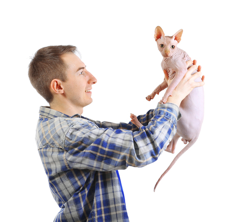 Young handsome man holding a cat, isolated on white Фото со стока