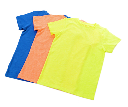 Colourful cotton T-shirt in a row isolated on white background Stock Photo