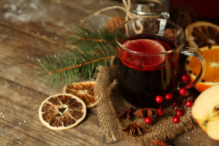 Beautiful Christmas composition of mulled wine on decorated wooden table