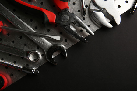 Different kinds of tools on dark background 스톡 콘텐츠