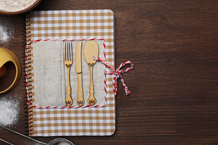 Decorated recipe book on wooden background, copy space