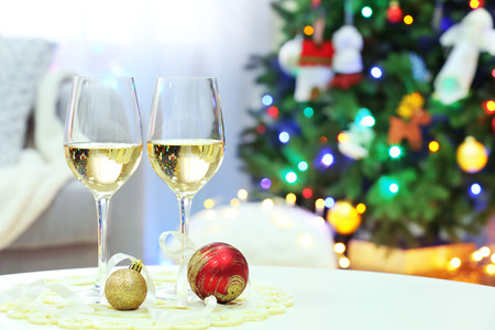 Two champagne glasses on Christmas tree background Stock Photo