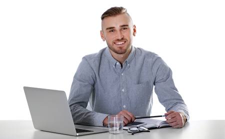 Businessman working with laptop on bright background