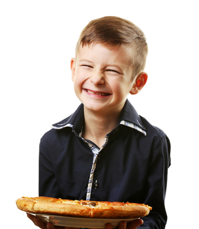 Little boy holding pizza isolated on white