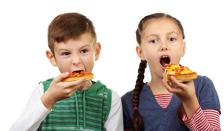 Children eating pizza isolated on white Stock Photo