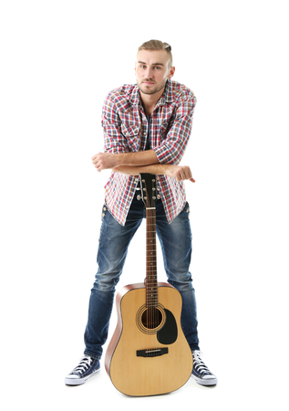 Young musician with guitar isolated on white Stok Fotoğraf