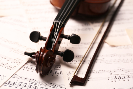 Violin neck on music papers background Stock Photo