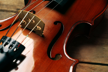 Violin on wooden background closeup