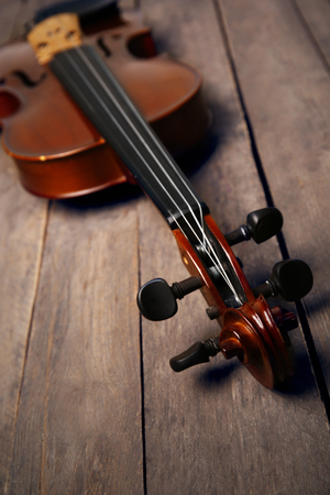 Violin on wooden background