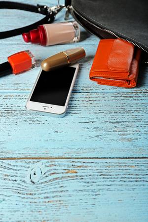 Ladies handbag on wooden background Stock Photo