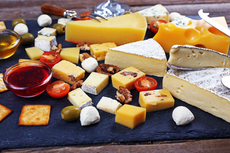 Cheese for tasting on wooden table, closeup Stock Photo