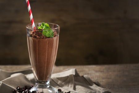 Chocolate cocktail on wooden background