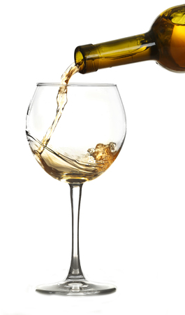 White wine pouring in glass, isolated on white Reklamní fotografie