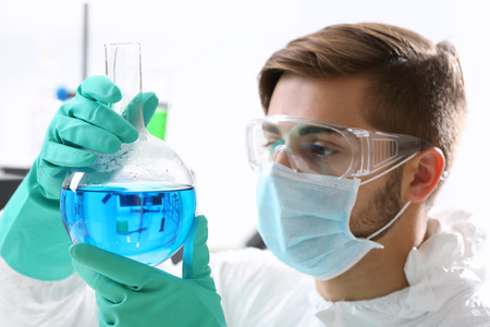 Man in laboratory checking test tubes Stock Photo