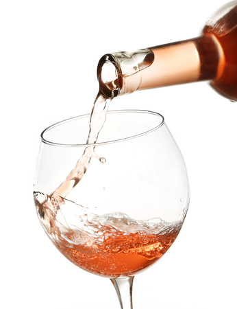 Rose wine pouring in glass, isolated on white Stock fotó - 103305737