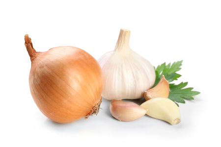 Garlic and onion with parsley leaves isolated on white