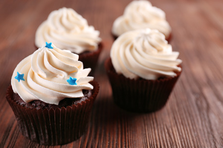Chocolate cupcakes on wooden background