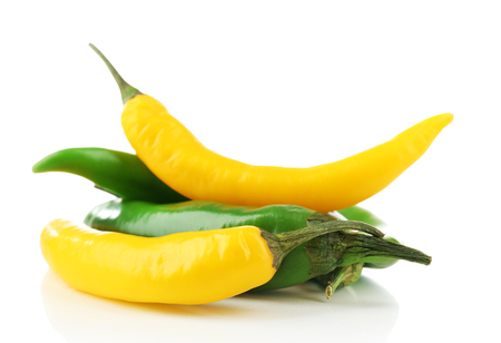 Yellow and green chili peppers isolated on white