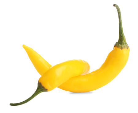 Yellow chili peppers isolated on white Stock Photo