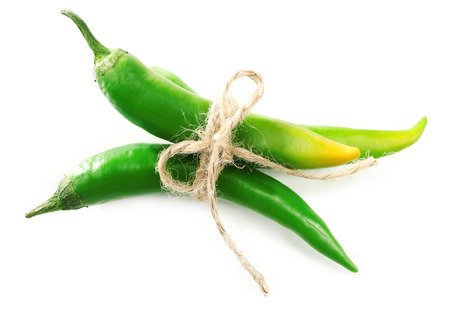 Green chili peppers isolated on white Stock Photo