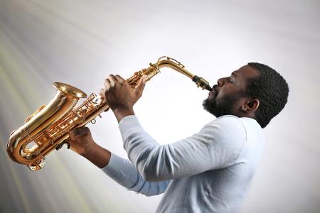 African American jazz musician playing the saxophone Foto de archivo