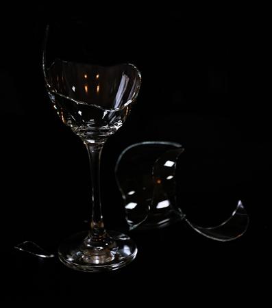 Broken wine glass on black background Stock Photo