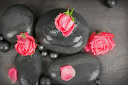 Beautiful spa composition with roses and stones