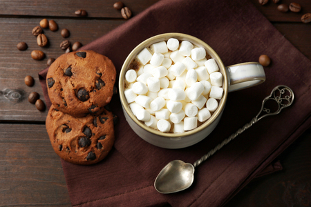 Mug of hot chocolate with marshmallows, on wooden background Banco de Imagens
