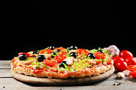 Delicious tasty pizza on black background