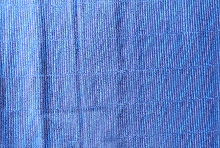 Blue cloth texture with uneven crumpled surface Banque d'images