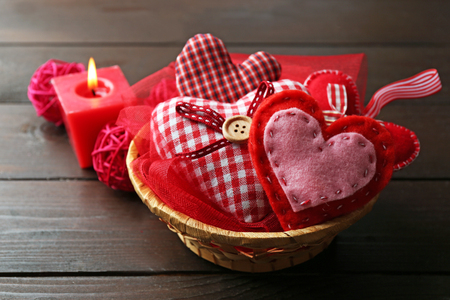 St Valentines decor in basket on wooden background Stock Photo