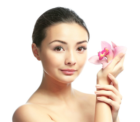 Portrait of beautiful woman with orchid flower which isolated on white background