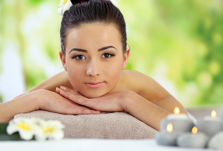 Young pretty woman relaxing in salon, close up Stock Photo