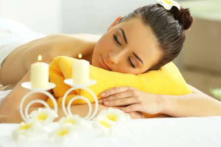 Young beautiful woman relaxing in salon, close up. Spa concept Stock Photo