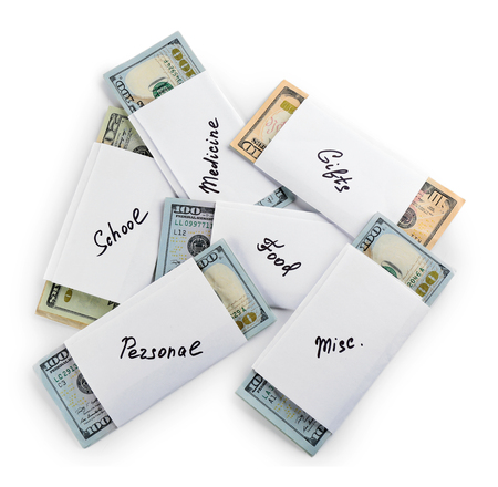 Rolls of money for needs isolated on white background Archivio Fotografico - 104445215