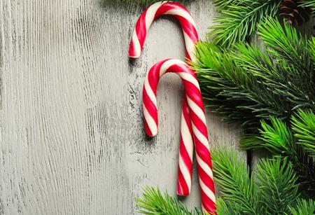 Lollipop candies on fir tree branches