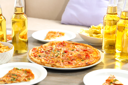 Table at home with pizza and drinks for friends Stock Photo
