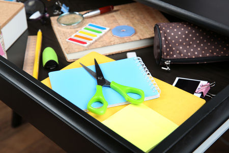 Stationery in open desk drawer closeup Archivio Fotografico